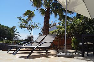 New holiday house with sunny terrace for rent in Cala Canyelles.