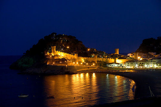 Illuminated city walls of Tossa de mar.
